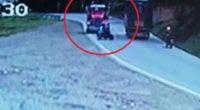 Motociclista adelanta en curva y se salva de milagro tras chocar contra camión